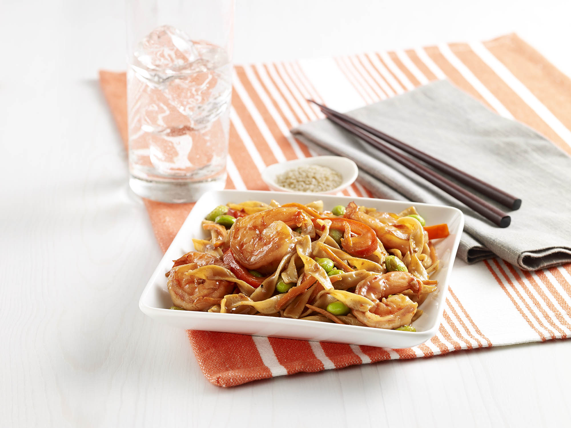 Pan Fried Noodles with Shrimp Pan fried egg noodle stir fry recipe combined with vegetables, shrimp and an Asian flavored sauce